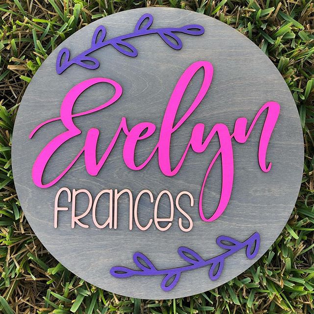"""No filter needed for this fun POP of colour! Leafy Vines is becoming one of our top sellers! . Size - 18"""" Stain - Earl Grey Paints - Bubblegum, Blush and Rockies Lettering Styles - 1 & 3 by @snowpeakprints! . #roundwoodsign #babynamesign #woodsigns #nurserydecor #nurseryinspo #pinkandpurplenursery #madeinwintergarden #mamamade #etsymama #shopsmall #collab #snowpeakprints"""