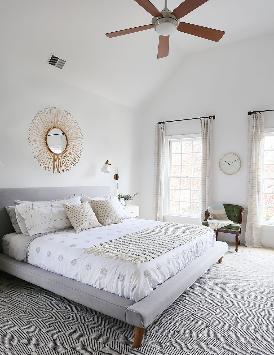 bed   /   bedding   /   rug   /   drapery rods   /   curtains   /   wall light   /   clock