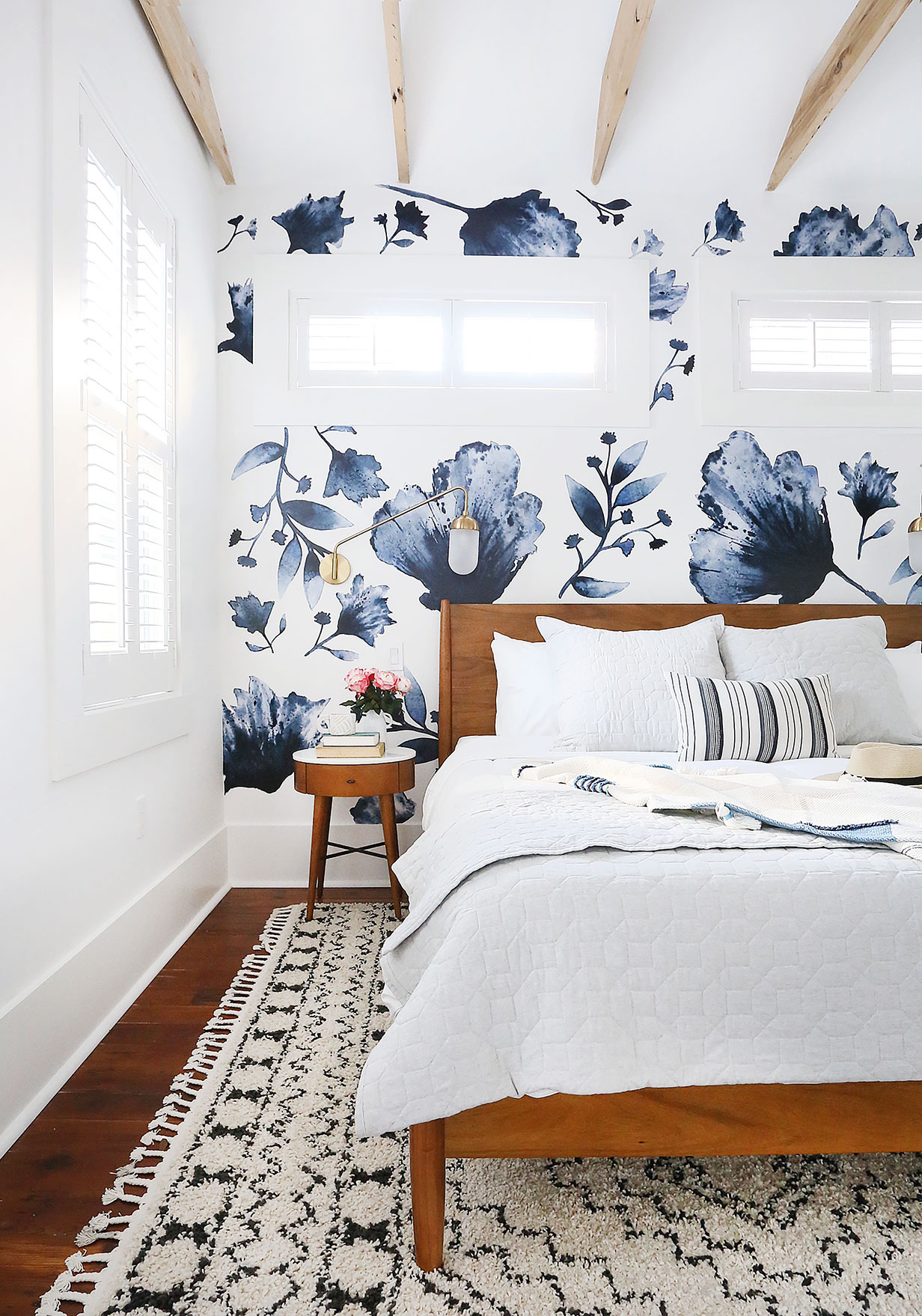 Floral Decals   /   Sconce   /   Bed   /   Bedding   /   Rug   /   Striped Pillow   /   Nightstand