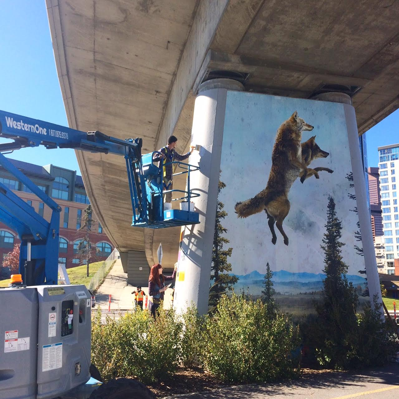 I rented a boom lift to be able to put up the artwork. Each abutment was about 20ft tall.
