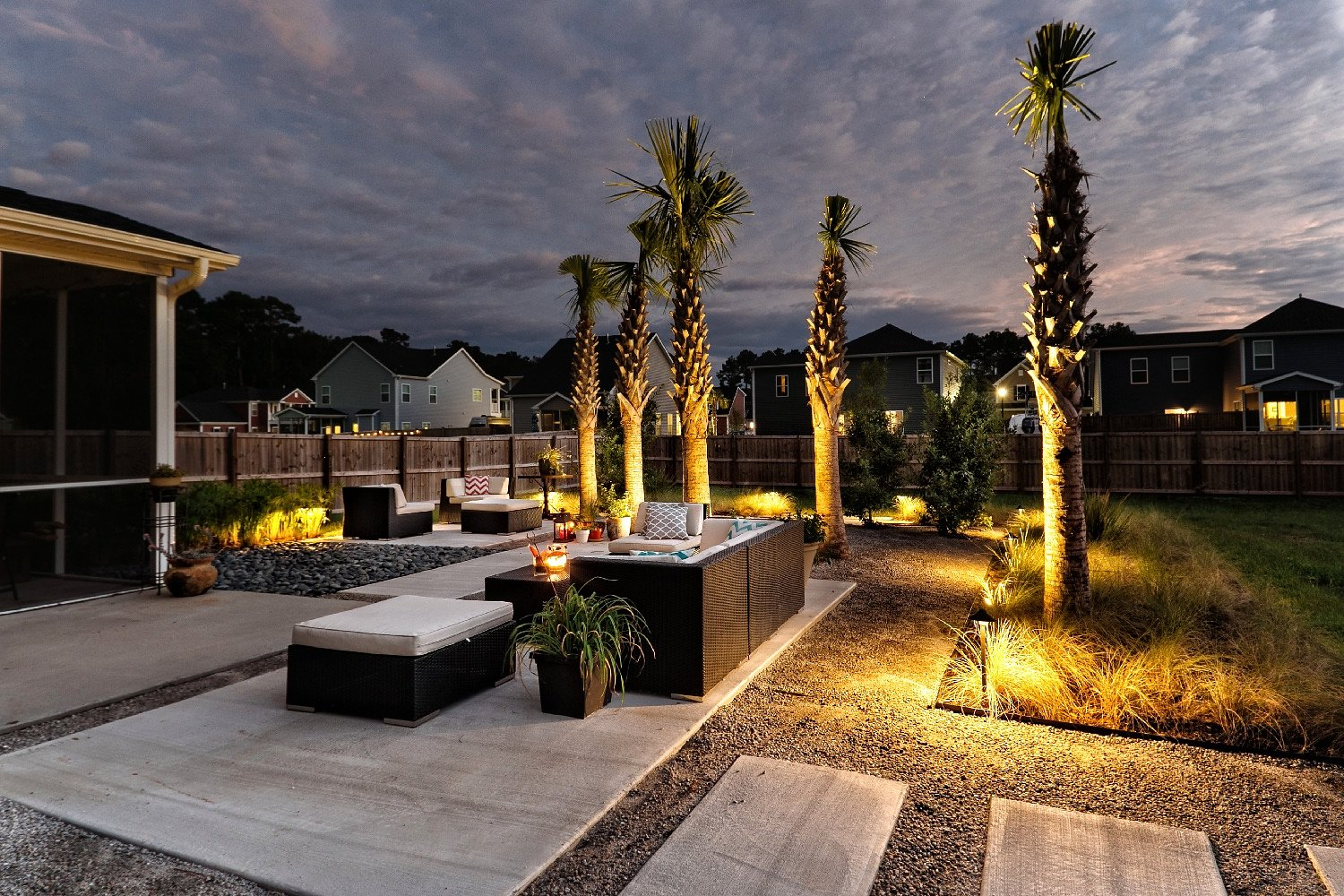 Landscape lighting brings the space to life at night.