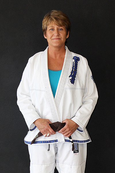 Jeannie Carter - InstructorJeannie is a Gracie Jiu-Jitsu Brown Belt under Black Belt Mike Braswell.