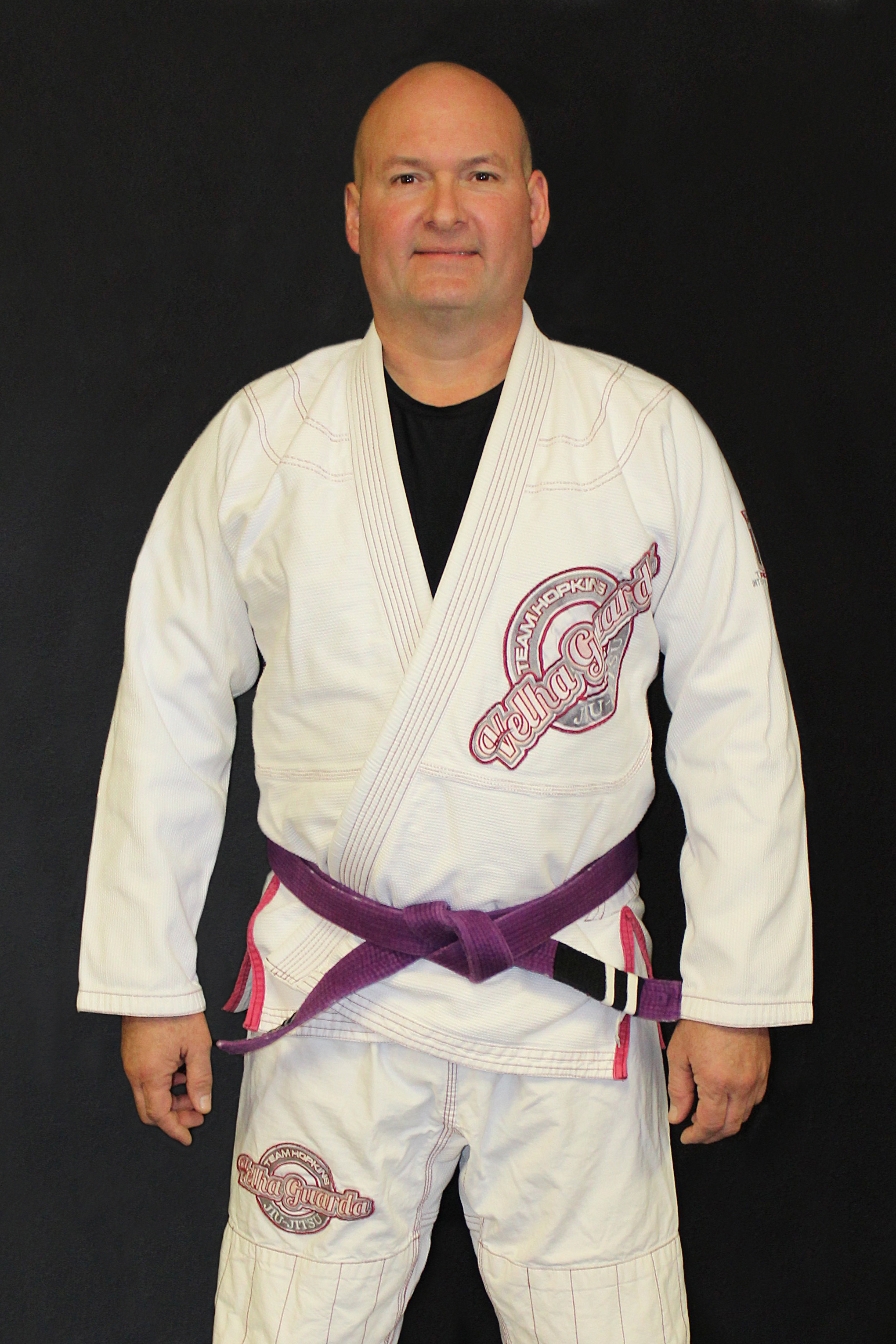 """Joe Boone - InstructorJoe is a Gracie Jiu-Jitsu Purple Belt under Black Belt Mike Braswell and has been training since 2008. He was awarded his Blue Belt in January 2015 by 3rd Degree Black Belt Allen Hopkins. Joe has been dubbed """"Shooter"""" at the Academy because of his extensive background in firearms which includes 20+ years combined experience in professional gunsmithing & firearms manufacturing. He holds the classification of Grandmaster in United States Practical Shooting Association (U.S.P.S.A.). His professional shooting career has taken him all over the United States, Europe, Africa, and Asia to compete."""