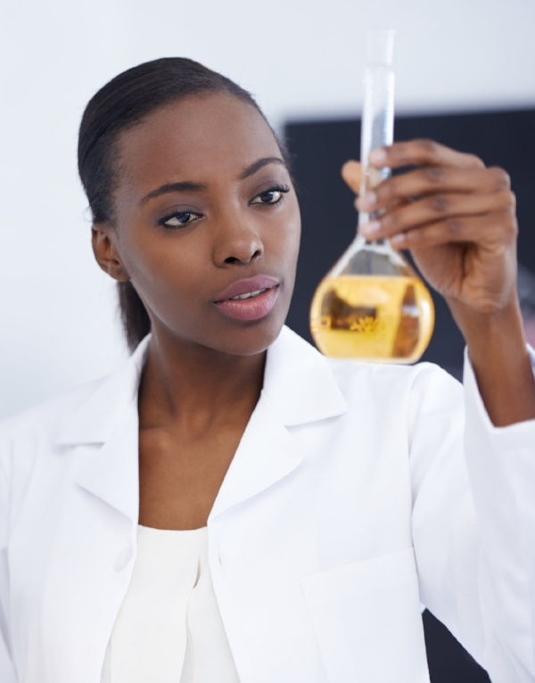 lab tech with golden oil