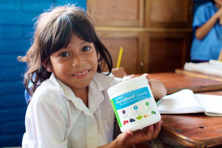 A child sharing their newest product from MannaRelief, a phyto-blend nutrititive powder.  © MannaRelief Images