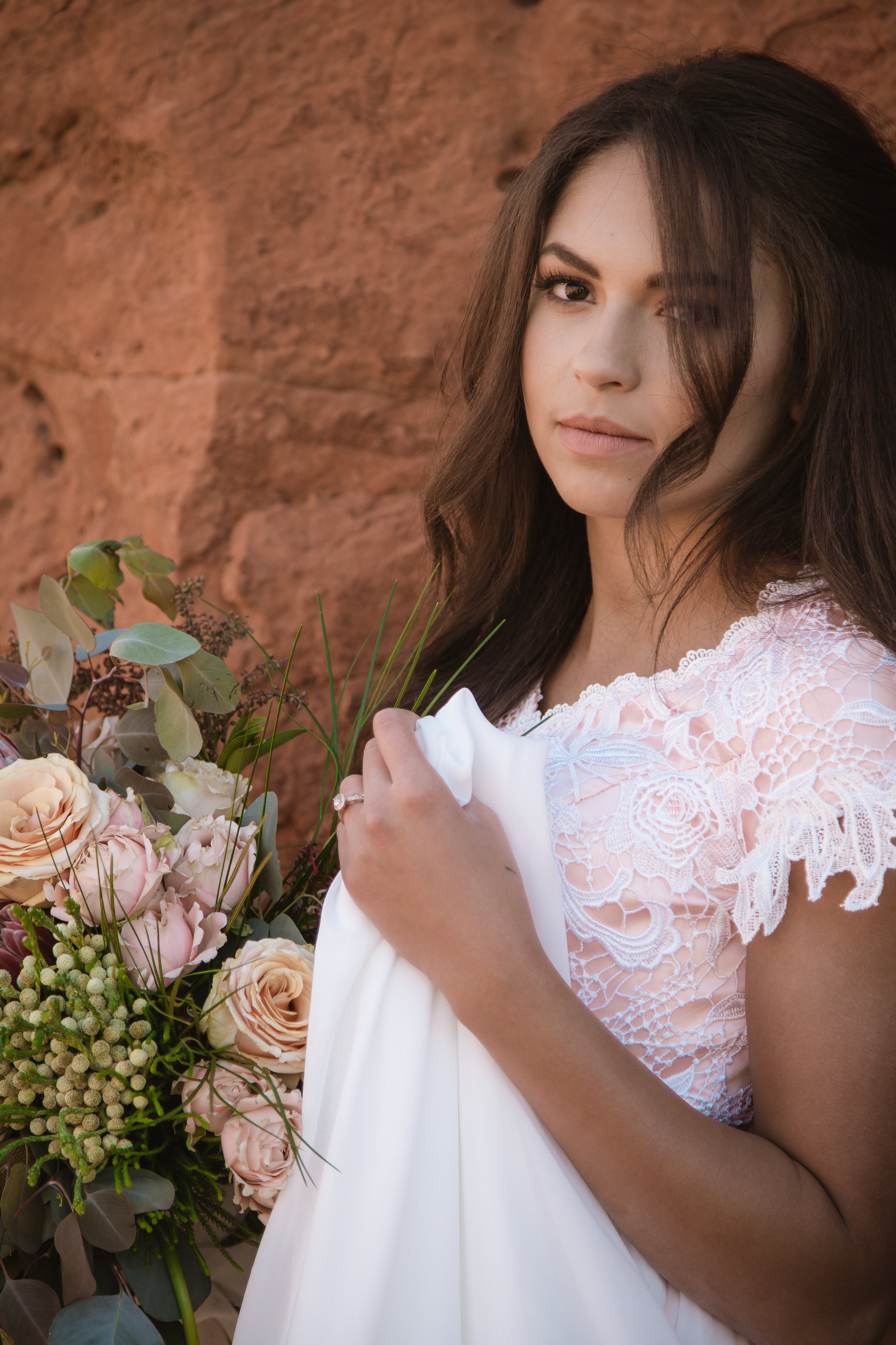Courtney Volksen Photography   Bride with beautiful red rock in Southern Utah