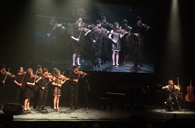 CSS Students performing with The Piano Guys