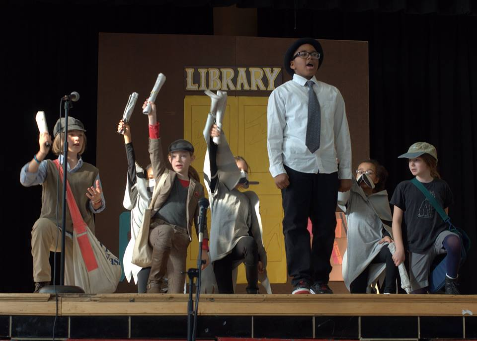 Stuart-Hobson Middle Schoolers perform with dramatic flair on the stage.