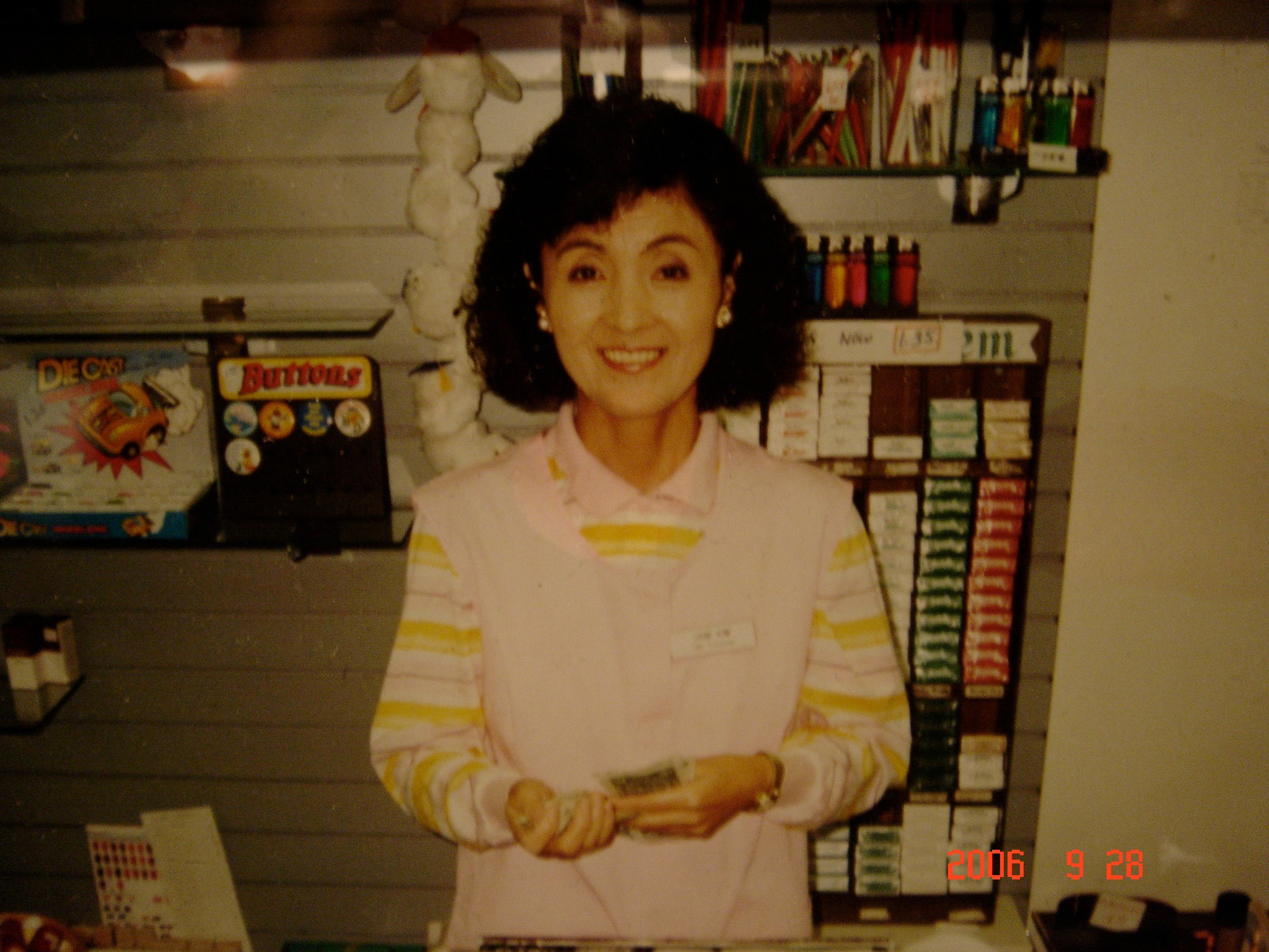 Jane Wha-Young Kim loved volunteering at the Guam Memorial Hospital. She particularly cherished holding newborns in the neonatal ward. Here she is manning the cash register at the hospital gift shop, in 1991.