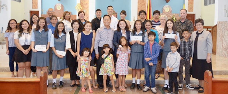 The Kim Family presents scholarships to four students at the Academy of Our Lady of Guam (August 2017)