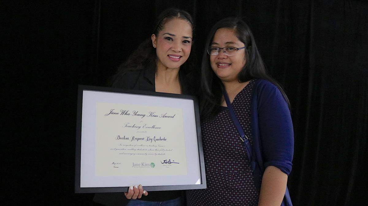 Darlene Quichocho, winner of the 2018 Jane Wha-Young Kim Award for Teaching Excellence, and Honorable Mention Patricia Anub (R). Photo credit: Dontana Keraskes/The Guam Daily Post