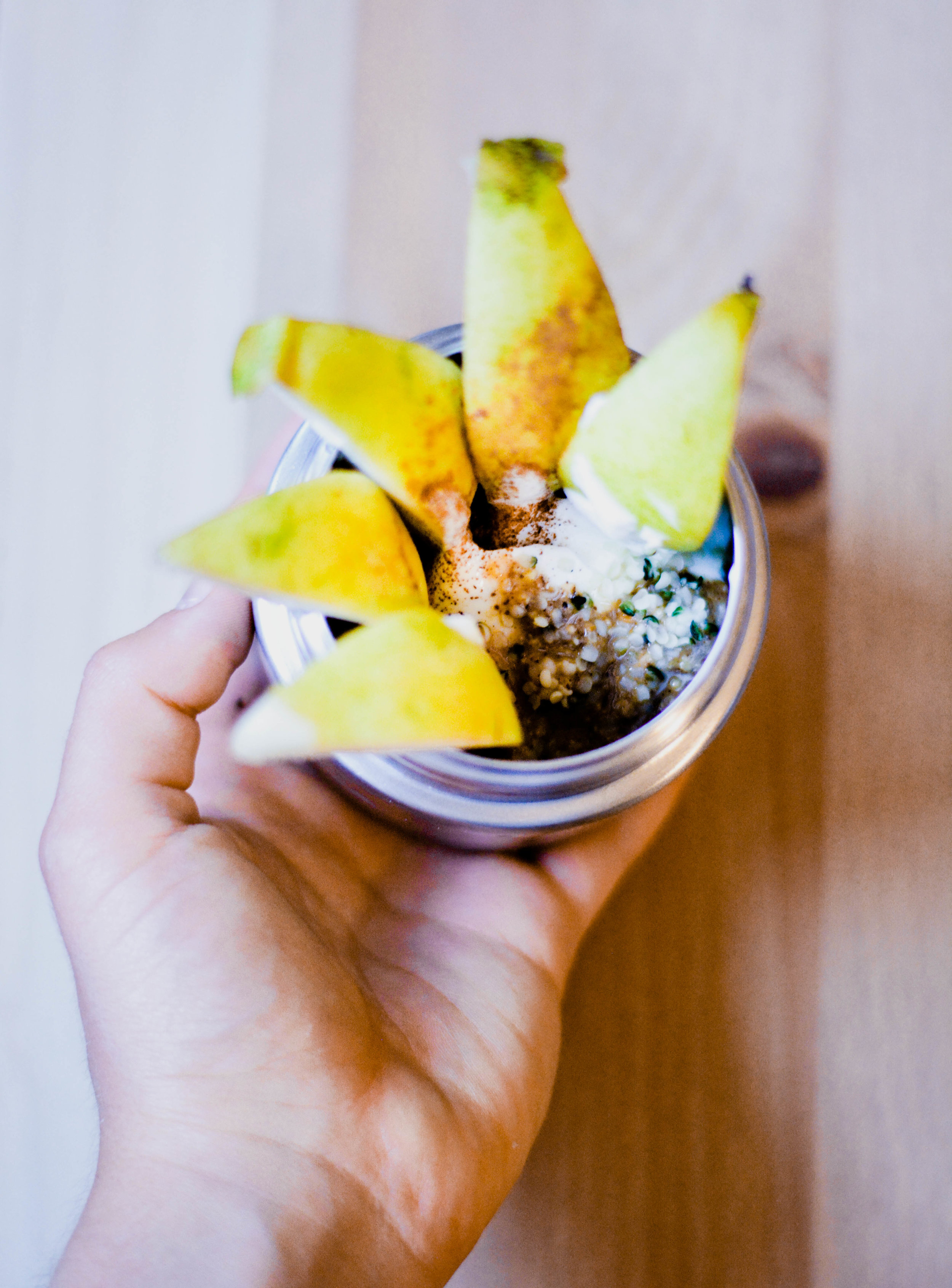 Whole milk yogurt with almond butter, pear, and hemp seeds.