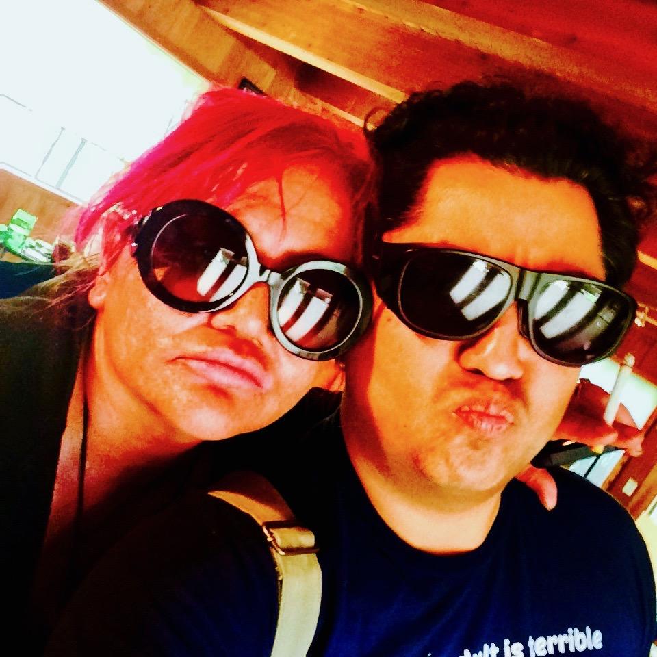 Stephanie and Marcos take a selfie as Nájera prepares to record a podcast episode.