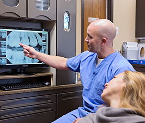Dr. Heath showing a patient a digital x-ray.  Photos by  Andrea Smyth Photography
