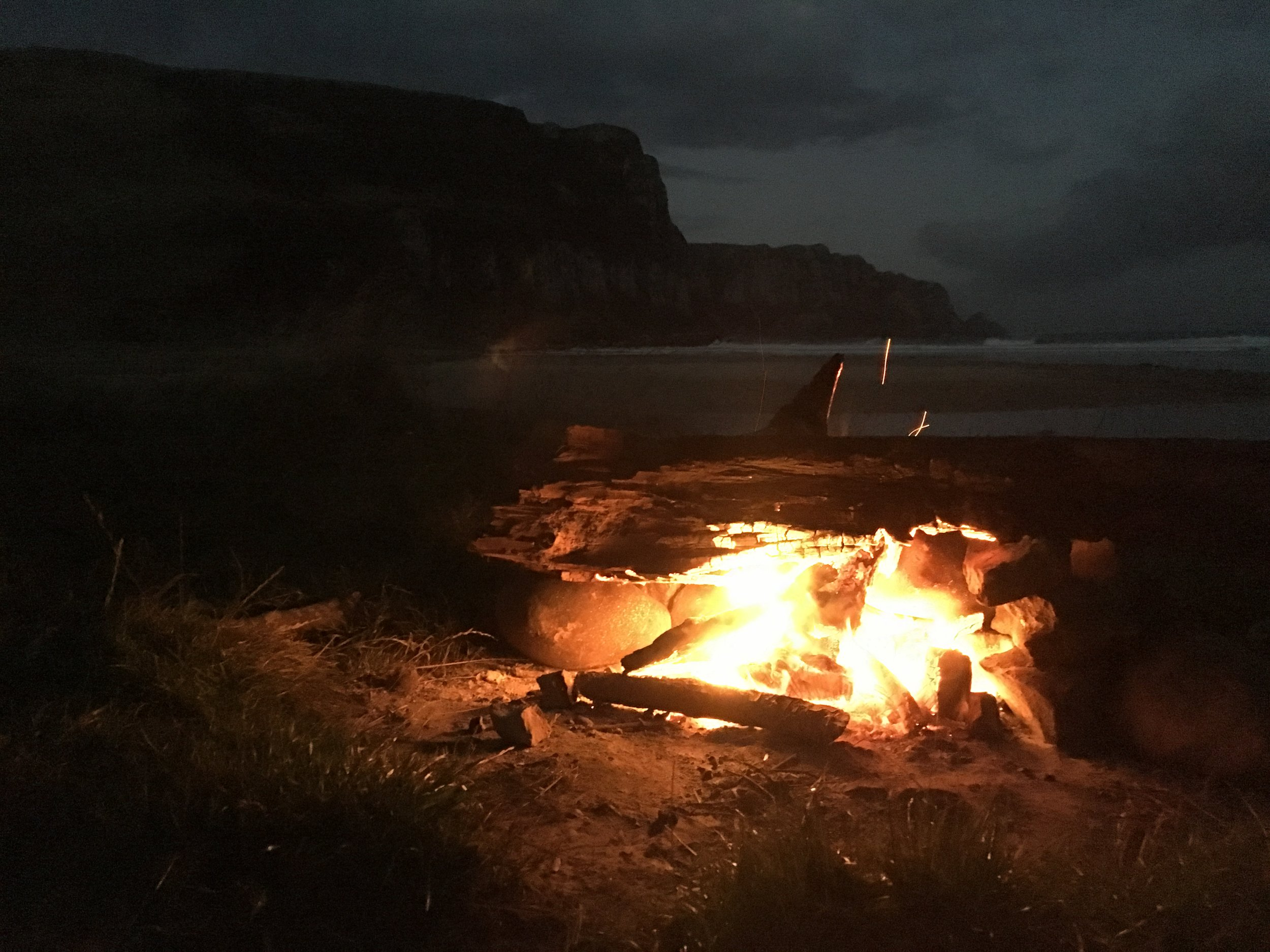 Bonfire and drinks with other campers at Purakaunui Bay