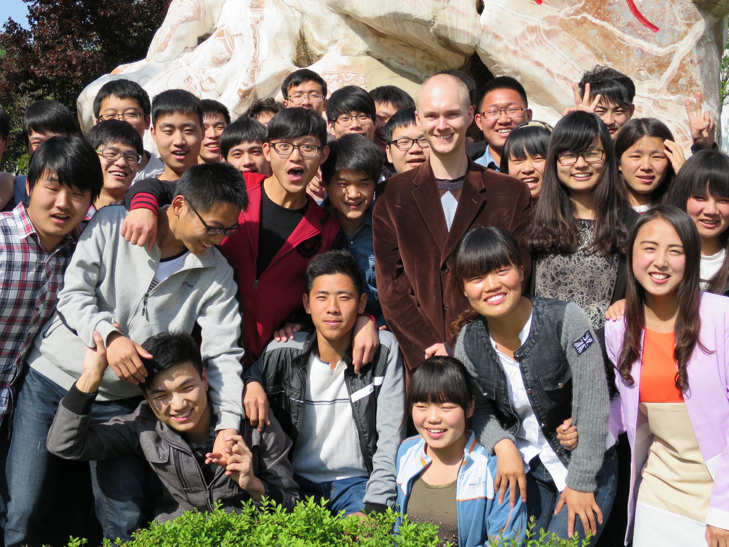 ESL Teacher with students.jpg