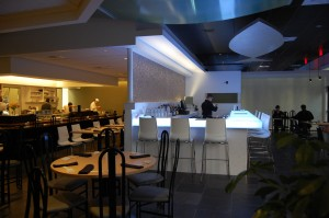 Glowing bar top and linear uplights from LED sources create a cool, hip vibe in the sake bar at Mizuno.