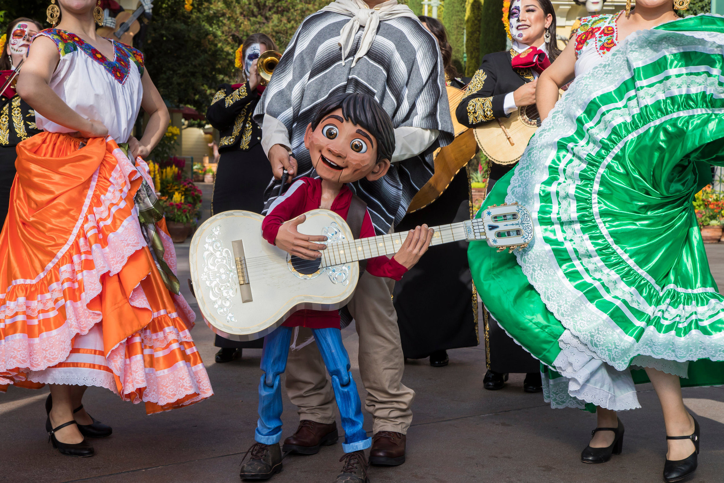 A Musical Celebration of Coco, taking place Sept. 6-Oct. 31, 2019, at Disney California Adventure Park, brings together the traveling Storytellers of Plaza de la Familia. In this festive performance, Miguel is joined by singing host Mateo, the Grammy® Award-winning Mariachi Divas and authentic folklórico dancers. The group entertains guests with beloved songs from the film, transporting everyone into the story of young Miguel's fantastical journey. Disneyland Resort is located in Anaheim, Calif. (Joshua Sudock/Disneyland Resort)
