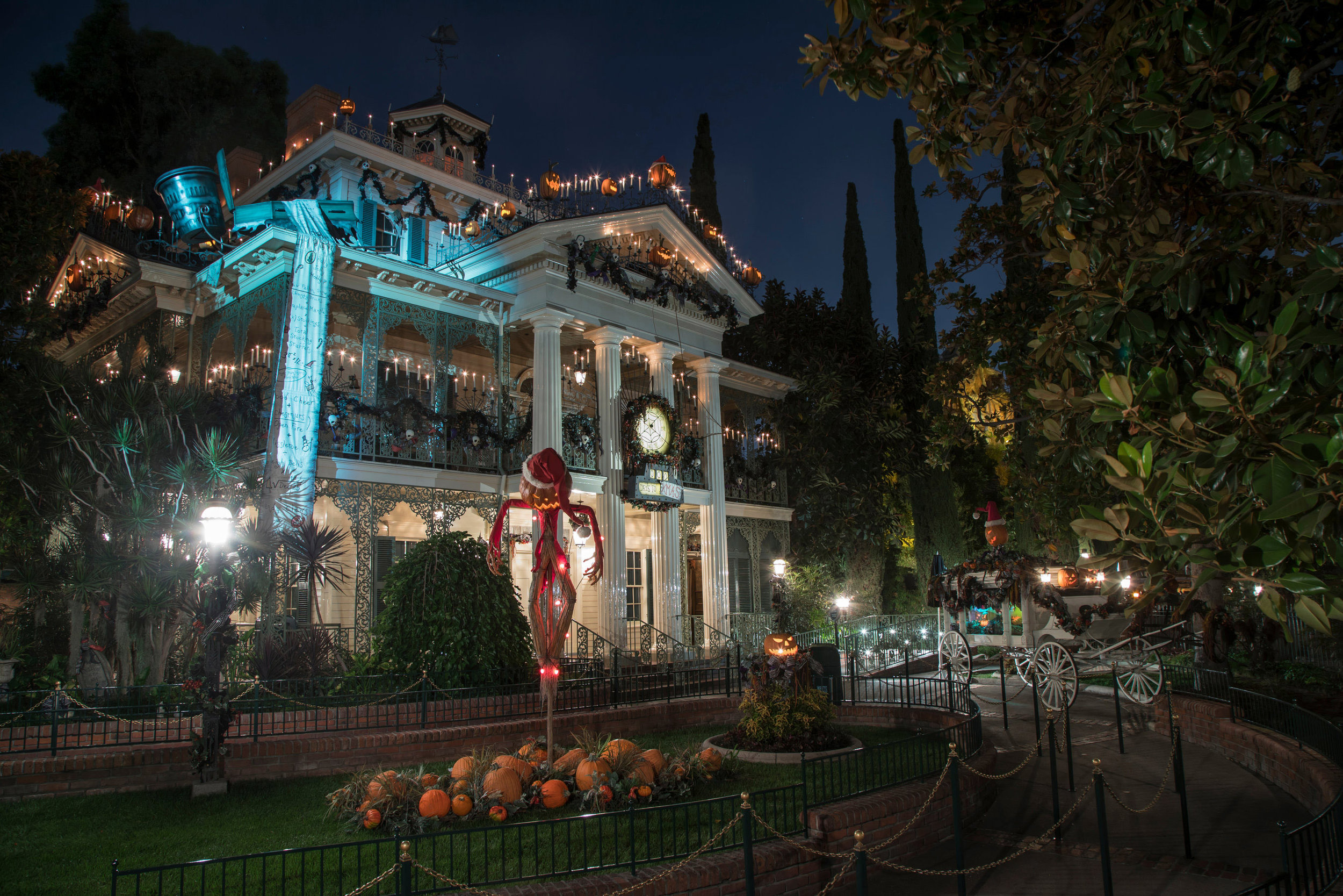 "During Halloween Time at Disneyland Park, from Sept. 6 through Oct. 31, 2019, the Haunted Mansion, which celebrates its 50th anniversary this summer, becomes Haunted Mansion Holiday, inspired by the Walt Disney Pictures classic ""Tim Burton's The Nightmare Before Christmas."" The seasonal attraction celebrates the collision between Halloween and Christmas as Jack Skellington offers his unique take on the holidays. Disneyland Resort is located in Anaheim, Calif.  (Joshua Sudock/Disneyland Resort)"