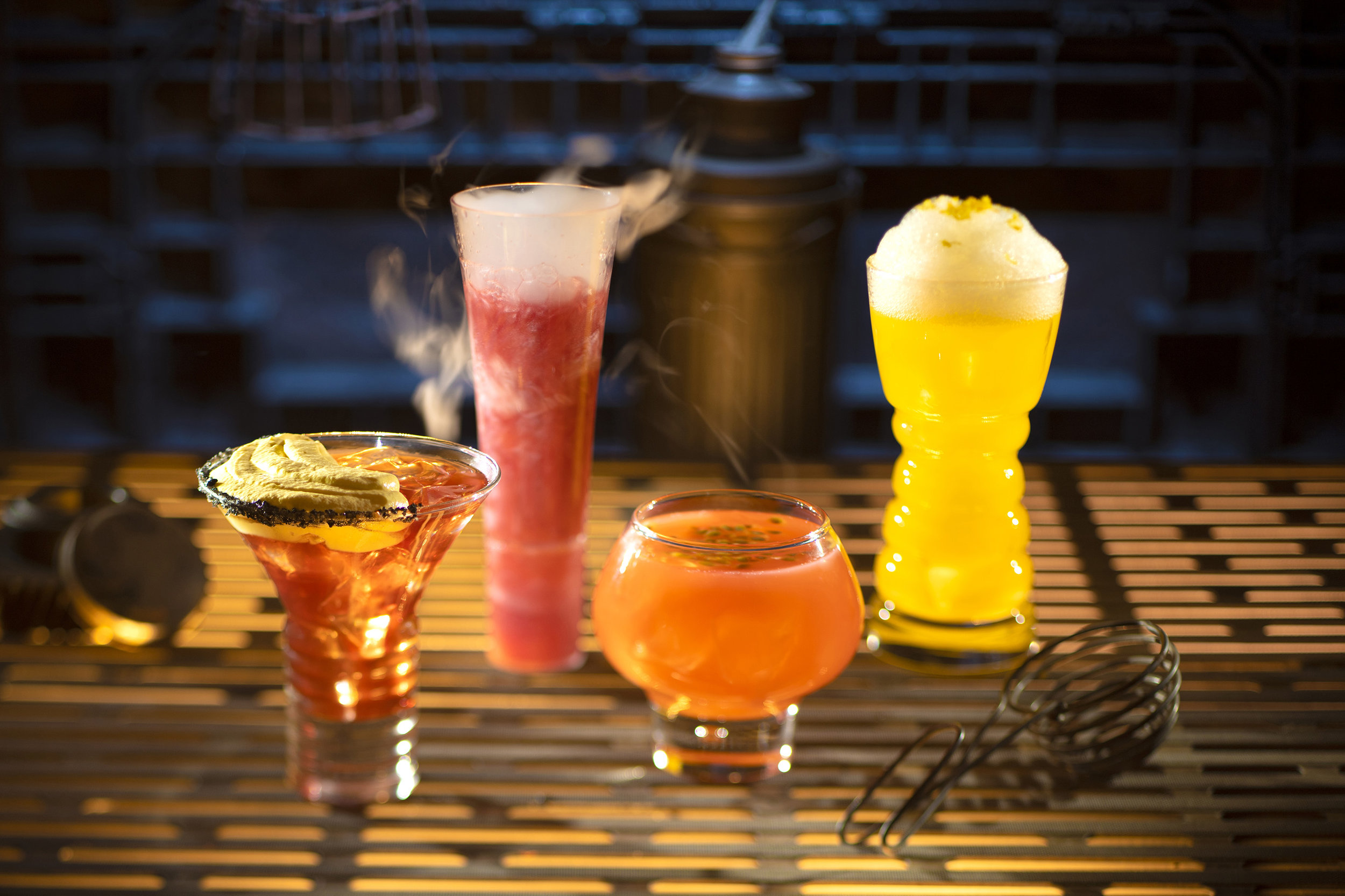 Guests will discover innovative and creative concoctions from around the galaxy at Star Wars: Galaxy's Edge at Disneyland Park in Anaheim, California and at Disney's Hollywood Studios in Lake Buena Vista, Florida. From left to right, alcoholic beverages: The Outer Rim, Bespin Fizz, Yub Nub, and Fuzzy Tauntaun can be found at Oga's Cantina. (Kent Phillips/Disney Parks)