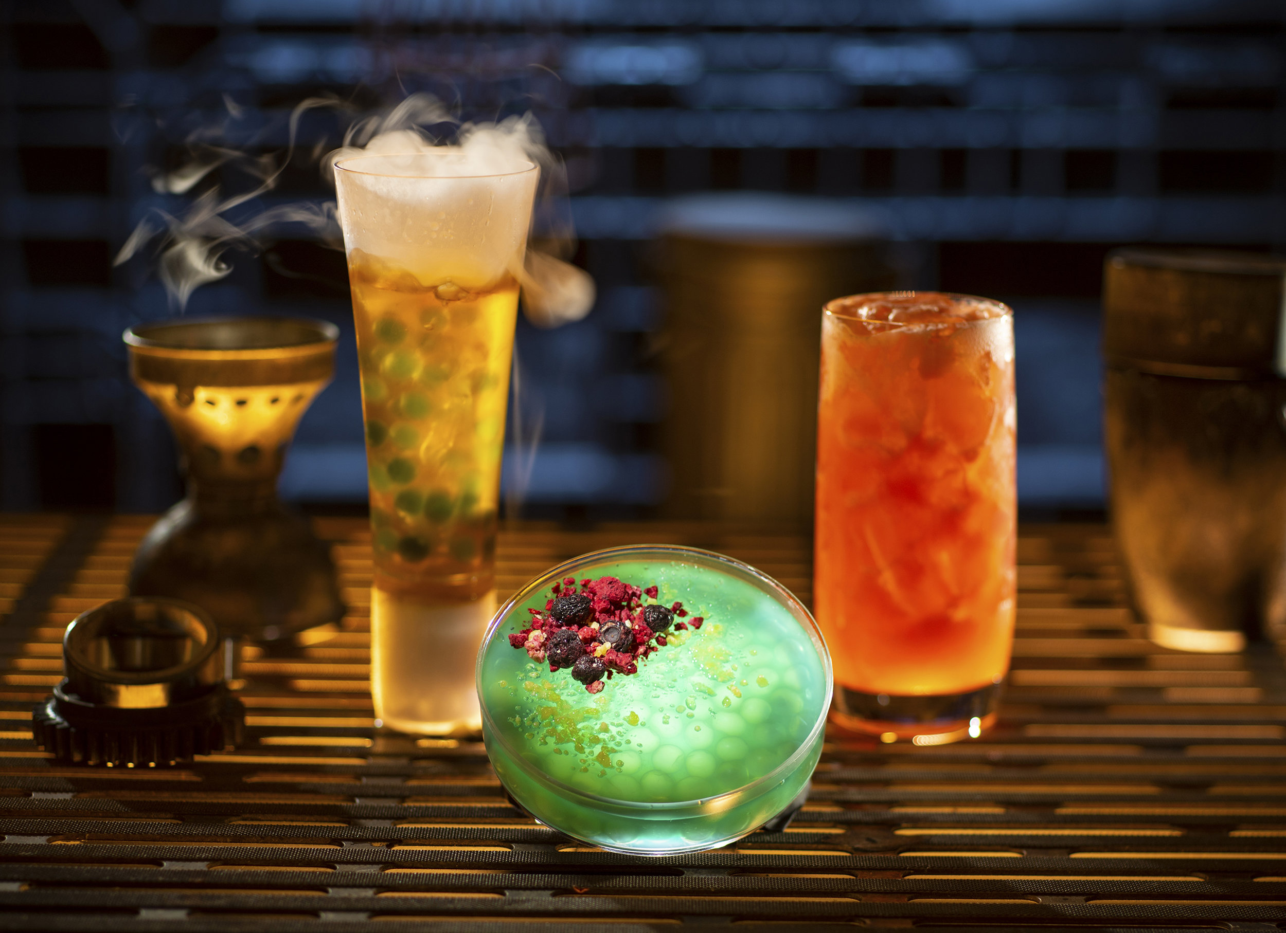 Guests will discover innovative and creative concoctions from around the galaxy at Star Wars: Galaxy's Edge at Disneyland Park in Anaheim, California and at Disney's Hollywood Studios in Lake Buena Vista, Florida. Left to right, non-alcoholic drinks: Carbon Freeze, Oga's Obsession provision and Cliff Dweller can be found at Oga's Cantina. (Kent Phillips/Disney Parks)