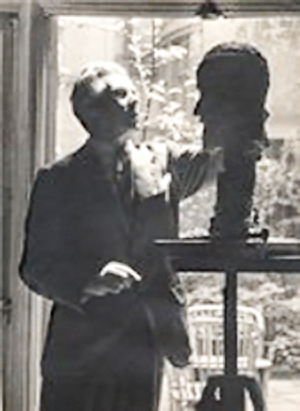 Famous American sculptor Antonio Salemmeworking on bust of Gerald Heard, 1950. - Salemme's 1951
