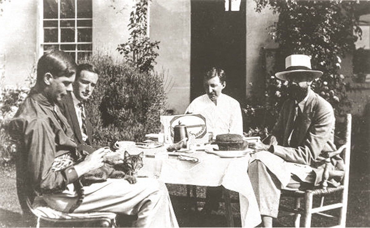 Jack Sprott, Gerald Heard, E. M. Forster, and Lytton Strachey at Strachey's Ham Spray House, c. late 1920s. - Photo used by kind permission of the Archive Centre, King's College, Cambridge.