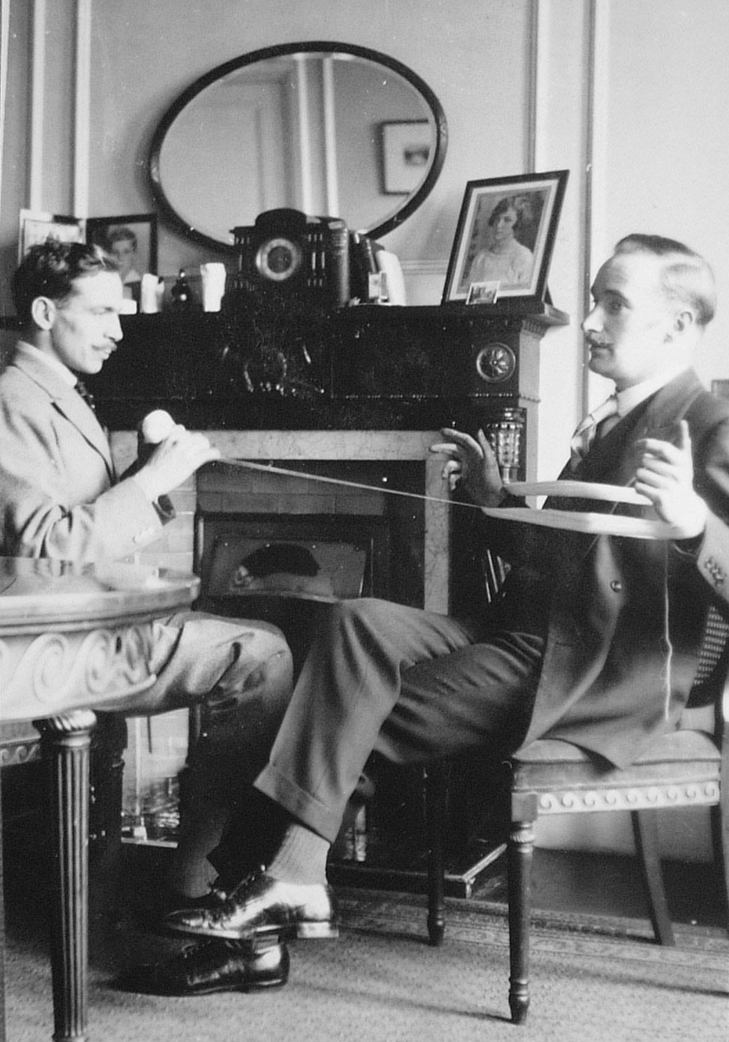 The earliest-known photograph of Gerald Heard — assisting Leonard Elmhirst winding a ball of yarn —Seymour Hotel, 1925. - Elmhirst's humorous description of this is as follows: