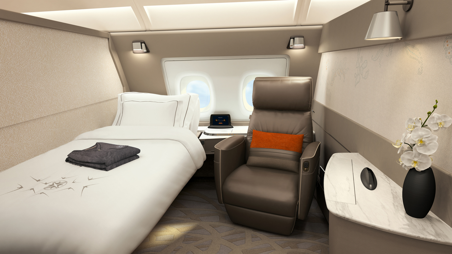 """The new """"bedroom"""" suite includes a Poltrona Frau leather chair, oh and did we mention a BED!?"""