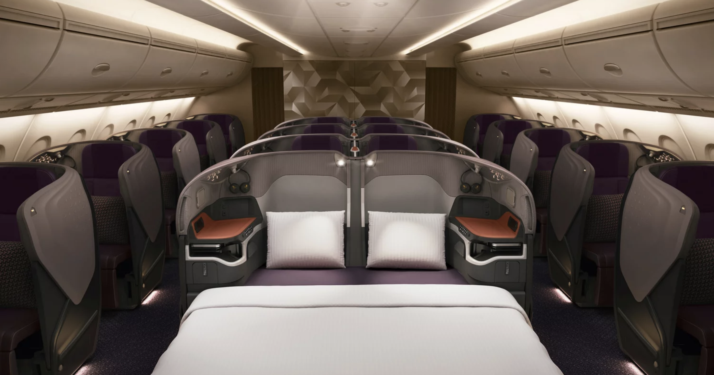The middle seats directly behind each three bulkhead cabin rows can convert into a double bed.