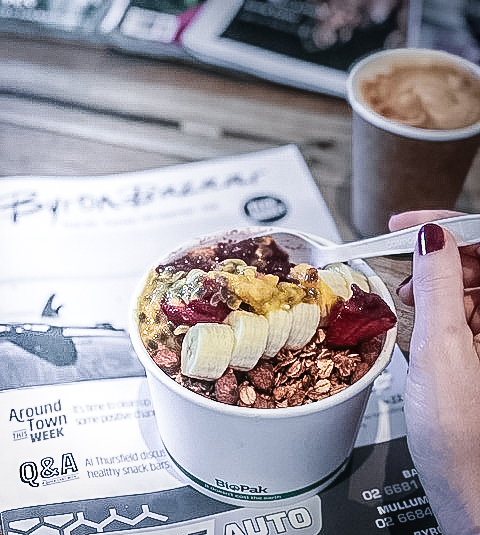 Acai Bowl topped with granola and passionfruit.