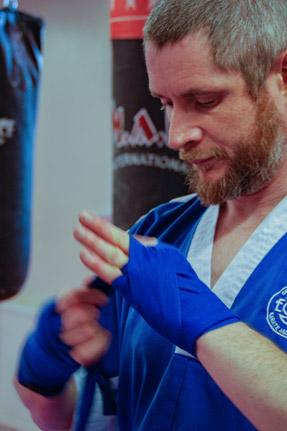 Sensei Geoff  5th Dan Black Belt  WAKO Qualified Instructor & International Referee  6 x ECKA National Champion  Three times inductee into martial arts Hall of Fame