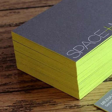 Edge coloured bright green/yellow business cards