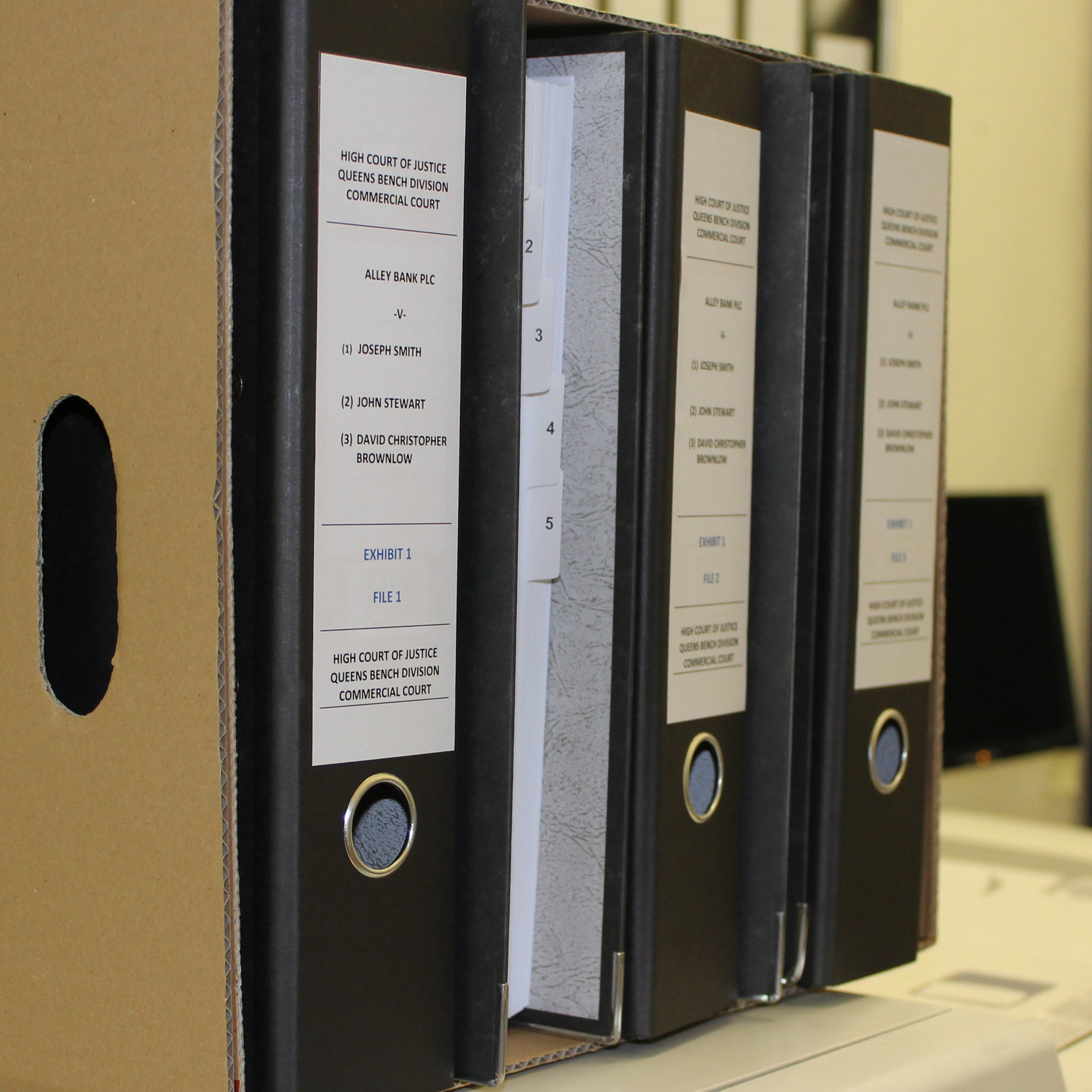 Box of lever arch files for legal clients