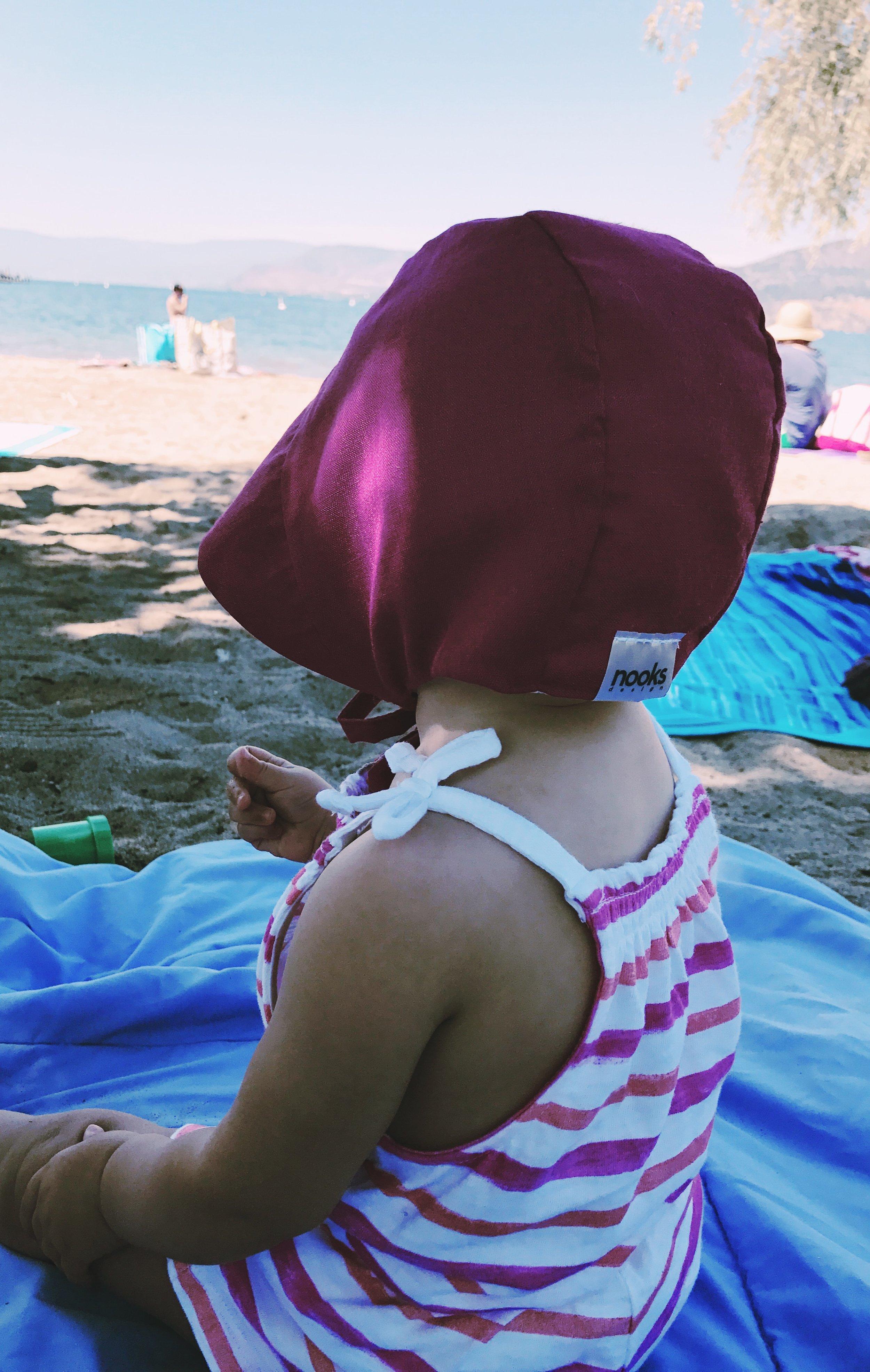 Joelle wearing a Nooks sun bonnet.