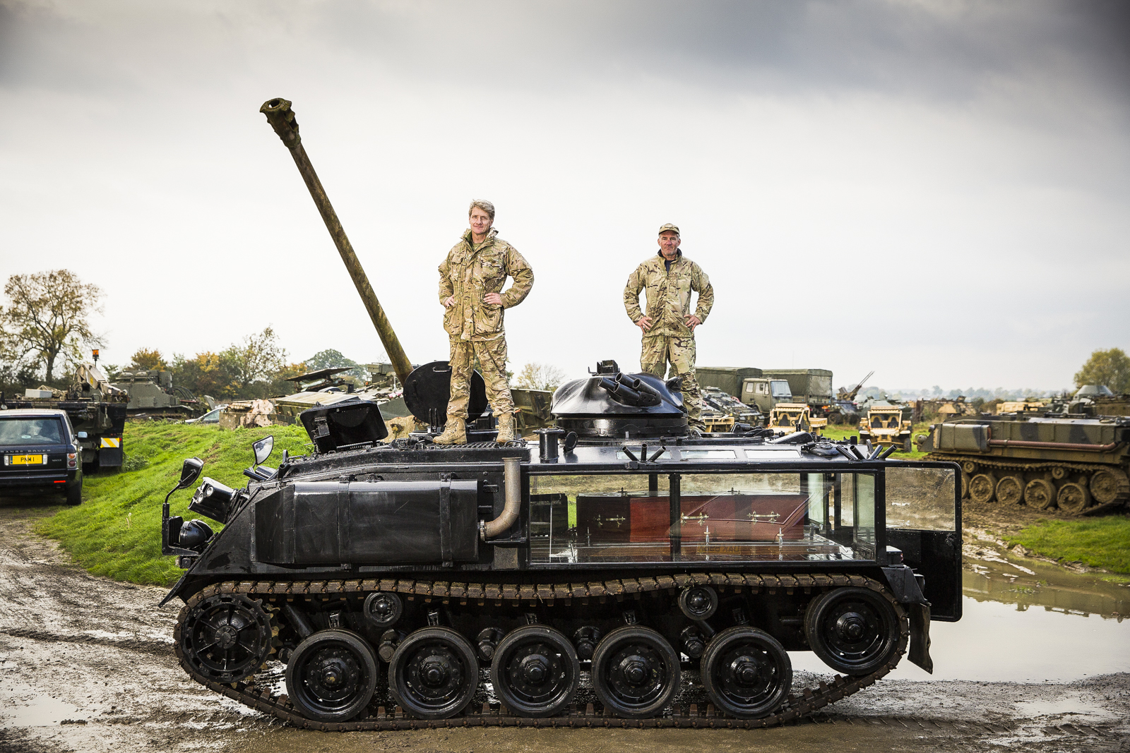 Nick Mead (L) and Todd Chamberlain with their converted  FV432 Armoured Personnel Carrier converted into a fully functioning funeral hearse