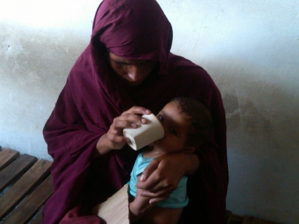 mom giving drip drop to dehydrated infant.jpg