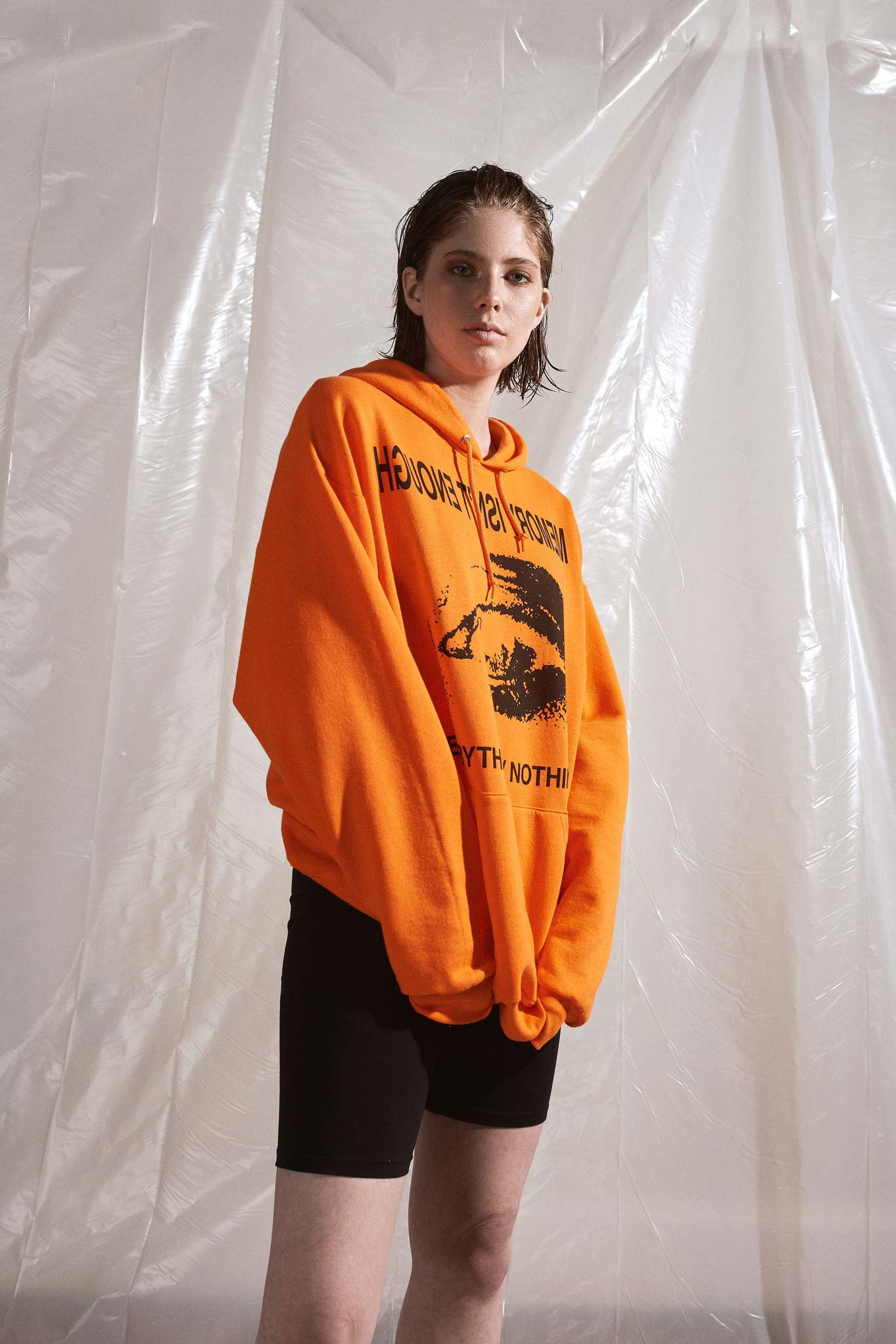 Model is wearing the  Memory Isn't Enough Oversized Safety Orange Hoodie