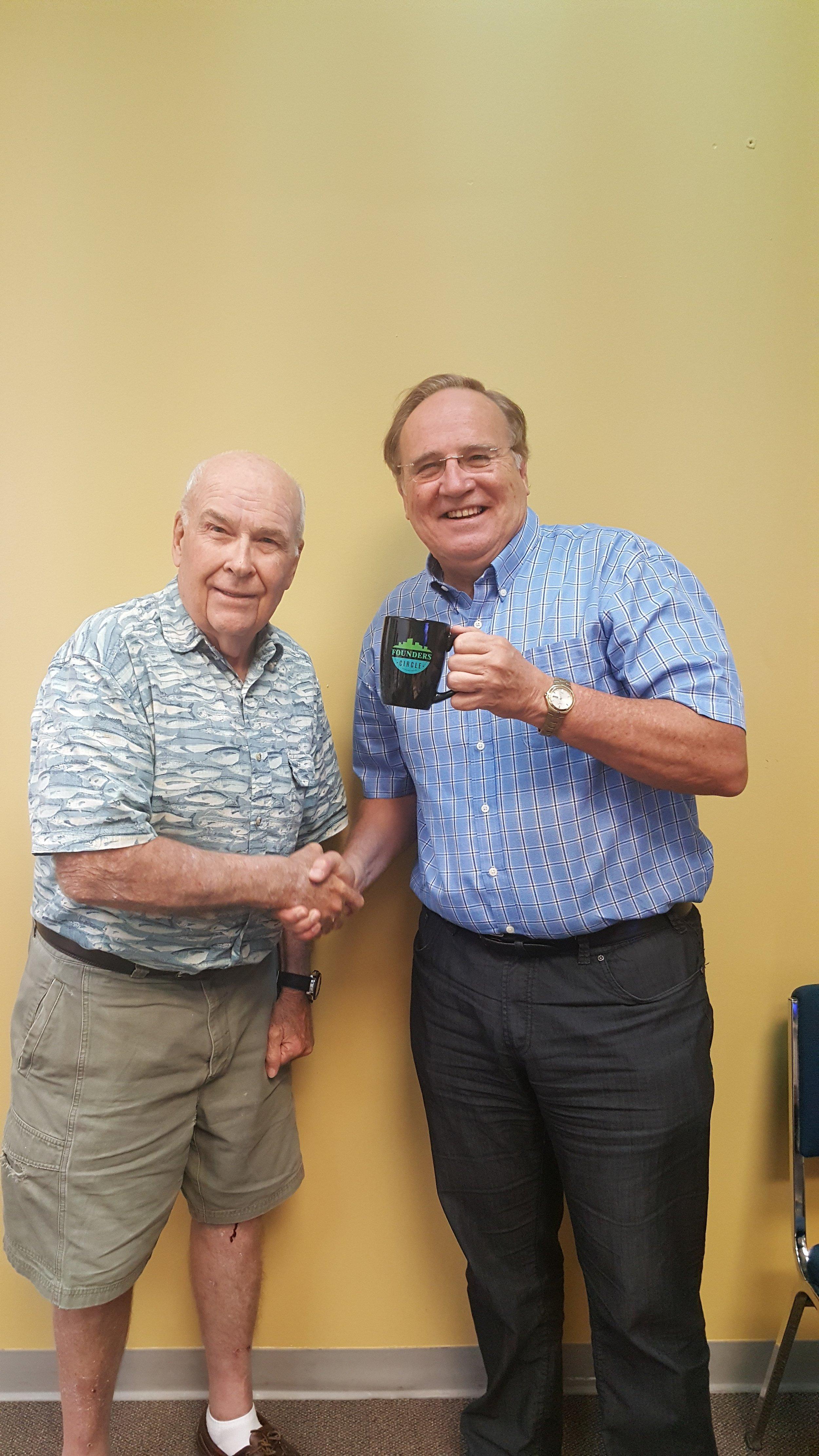 Stuart Morley presenting the Founders Circle mug to John Cooper