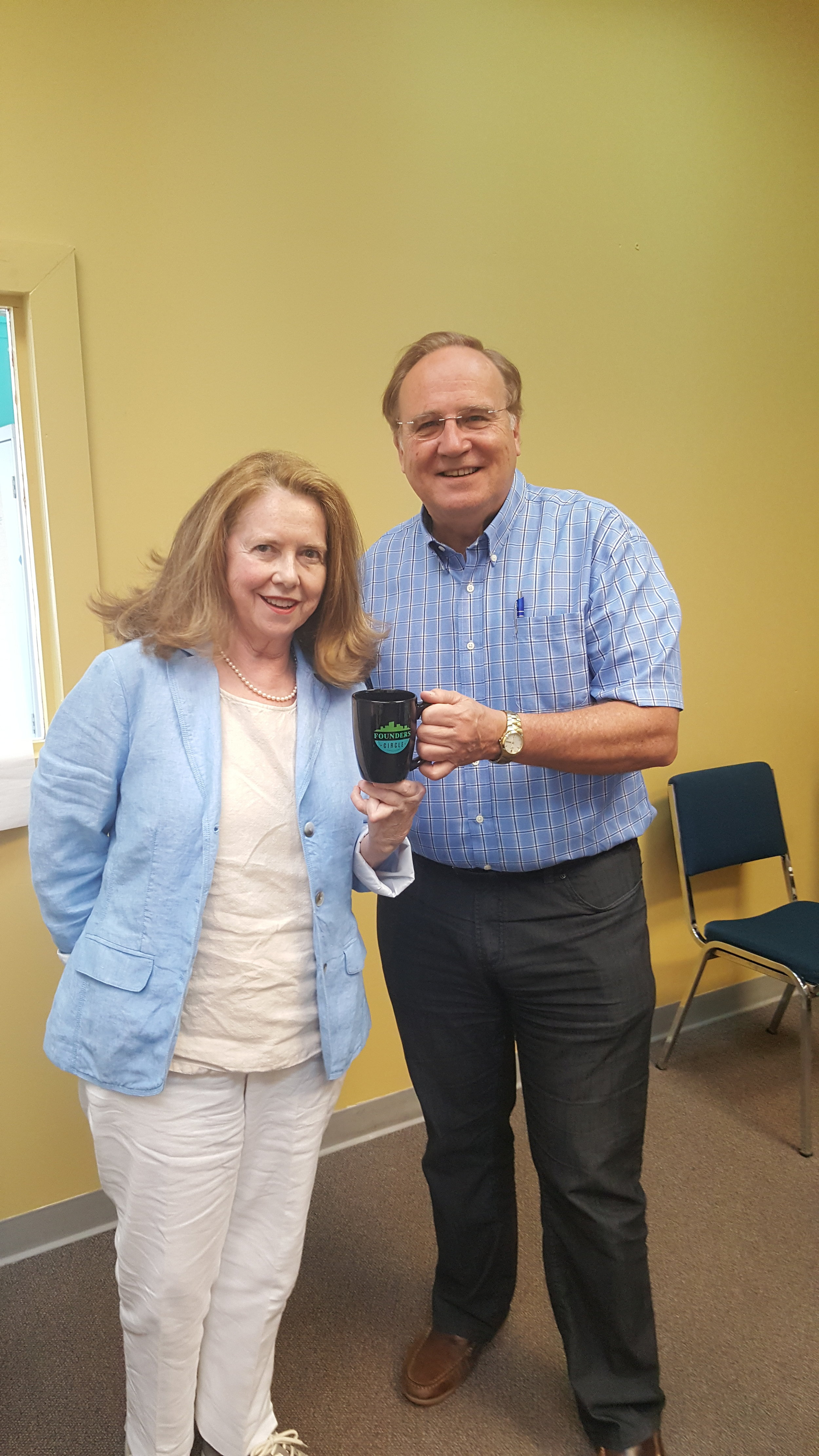 Stuart Morley presenting the mug to Maureen Cibberley who is the PMCN rep on Founders Circle