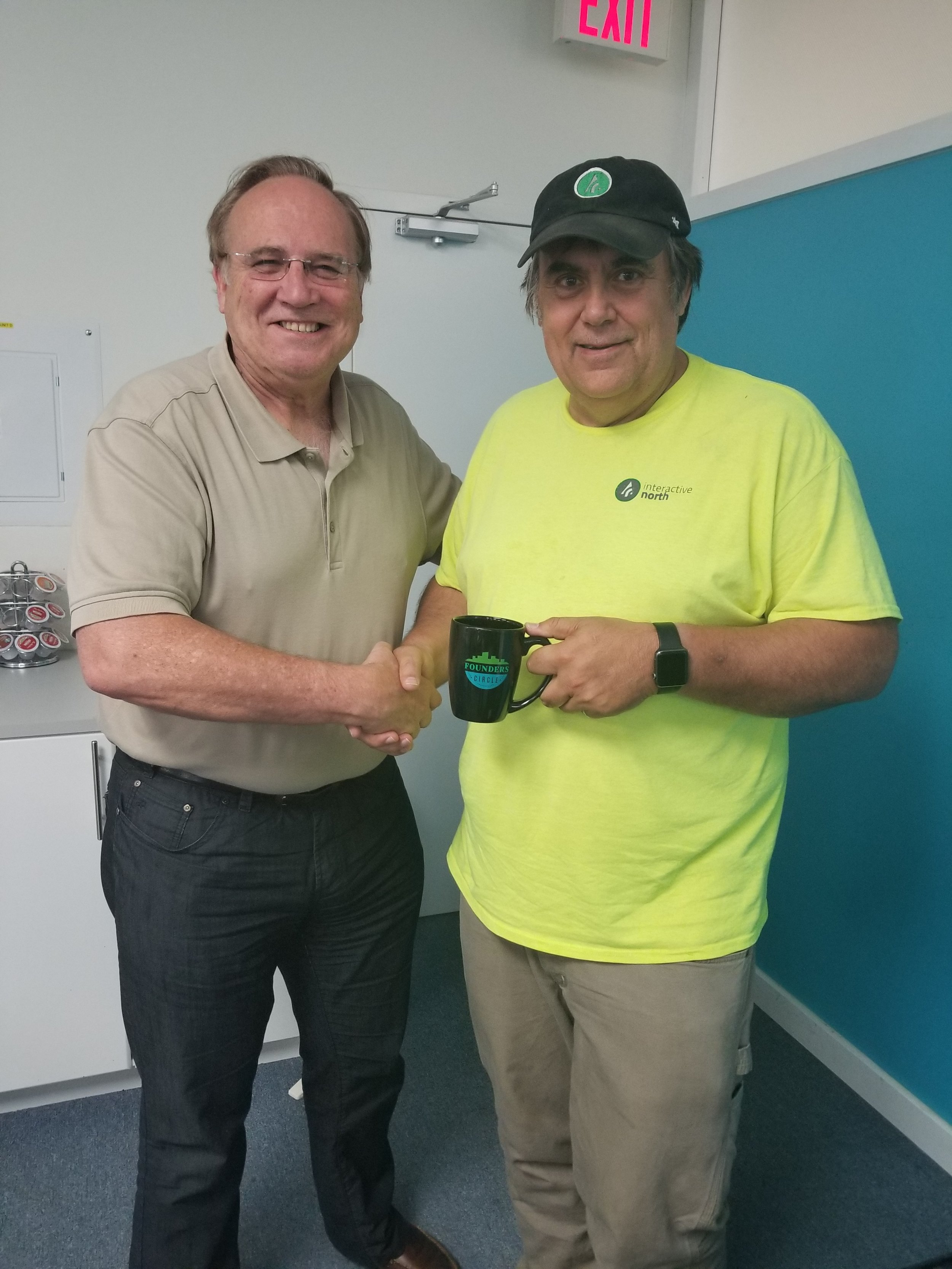 Stuart Morley presenting the Founders Circle mug to Neil Smellie