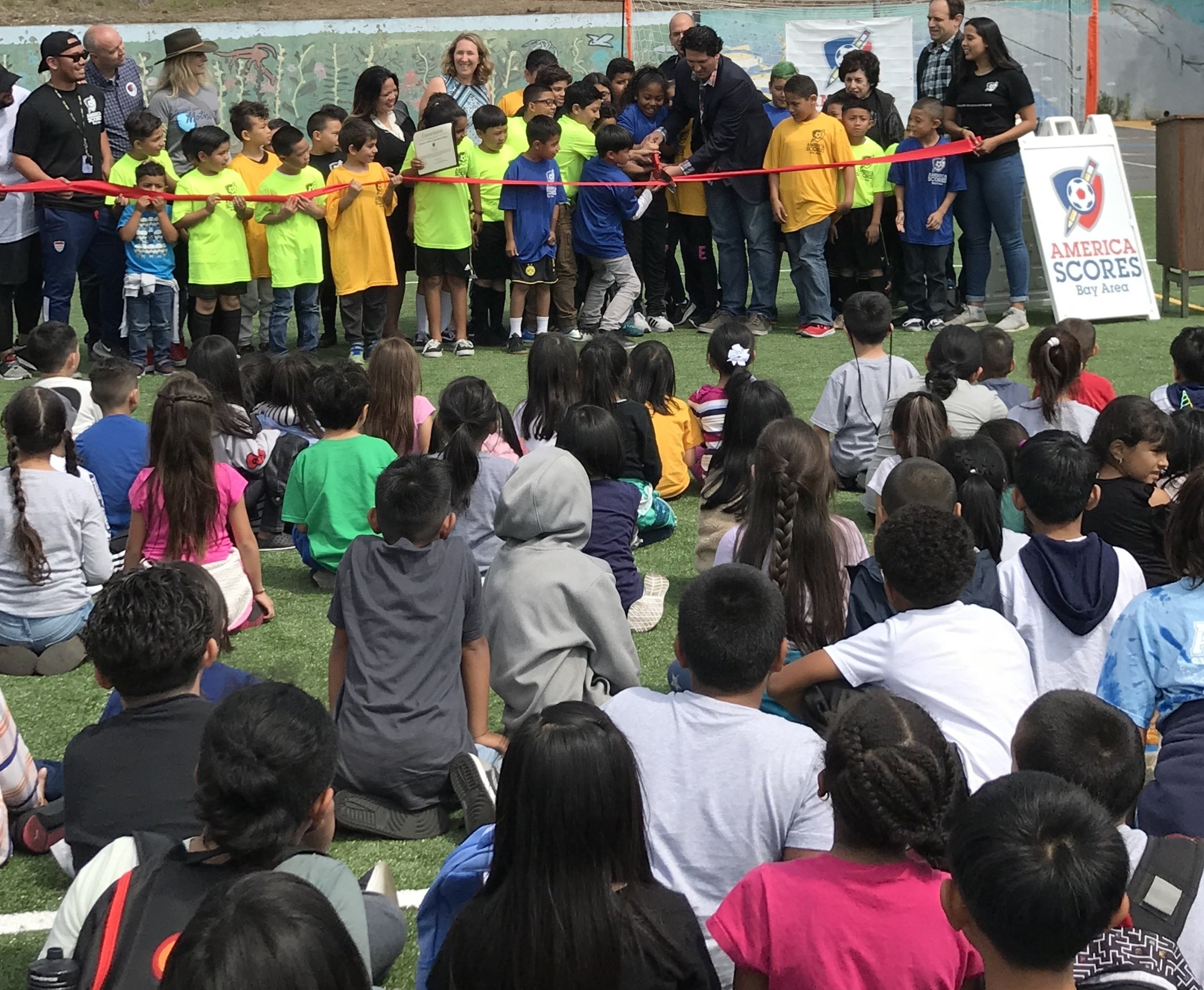 Daly City Supervisor  David Canepa  helps Woodrow Wilson Elementary Students cut the ribbon to their new America SCORES Field of Dreams