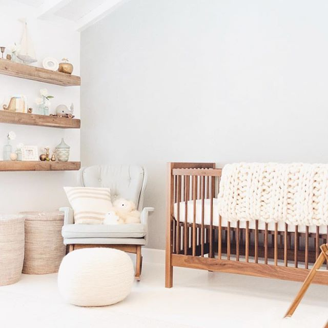 "I couldn't resist this beautifully styled and adorable nursery of Lauren Conrad's, for her son Liam! Love the peaceful, simplicity yet sophistication AND the neutrals with wood elements mixed in. And always love floating shelves. ⭐️ ⭐️ My favorite part of this room, besides for ""everything"" are the thick floating shelves. What is YOUR fave thing...the shelfies, neutral tone, chair and ottoman, wooden crib, storage bins, toys, thick knit throw, all of the above?👇🏻👇🏻👇🏻 ⭐️ ⭐️ If you are not already following Lauren @laurenconrad she has a gorgeous account...enjoy taking a peek. . . . . . . . . . . #architecturaldigest #babynursery #bedroomdesign #bedroominspo #bedroominspiration #bedroomgoals #bedrooms #bedroomstyle #bedroomstyling #boysroom #cratekids #dreambedroom #elledecor #followfriday #houzz #lovemypbk #kathykuohome #modernbedroom #neutraldecor #nursery #pocketofmyhome #potterybarn #potterybarnkids #rhbabyandchild #restorationhardware #roomforinspo #serenaandlily #shelfdecor #shelfgoals #shelfie"