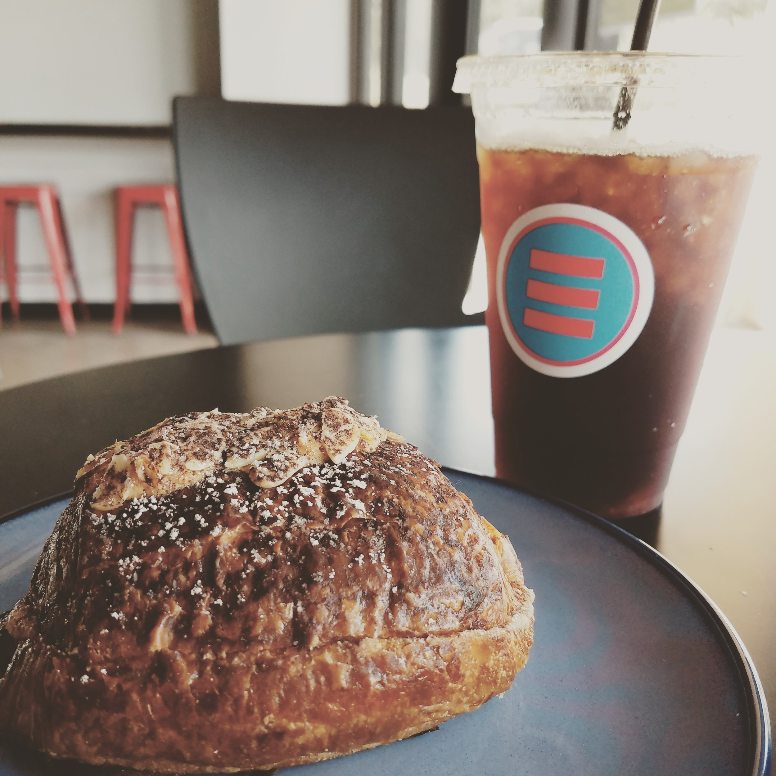 Iced coffee and chocolate croissant