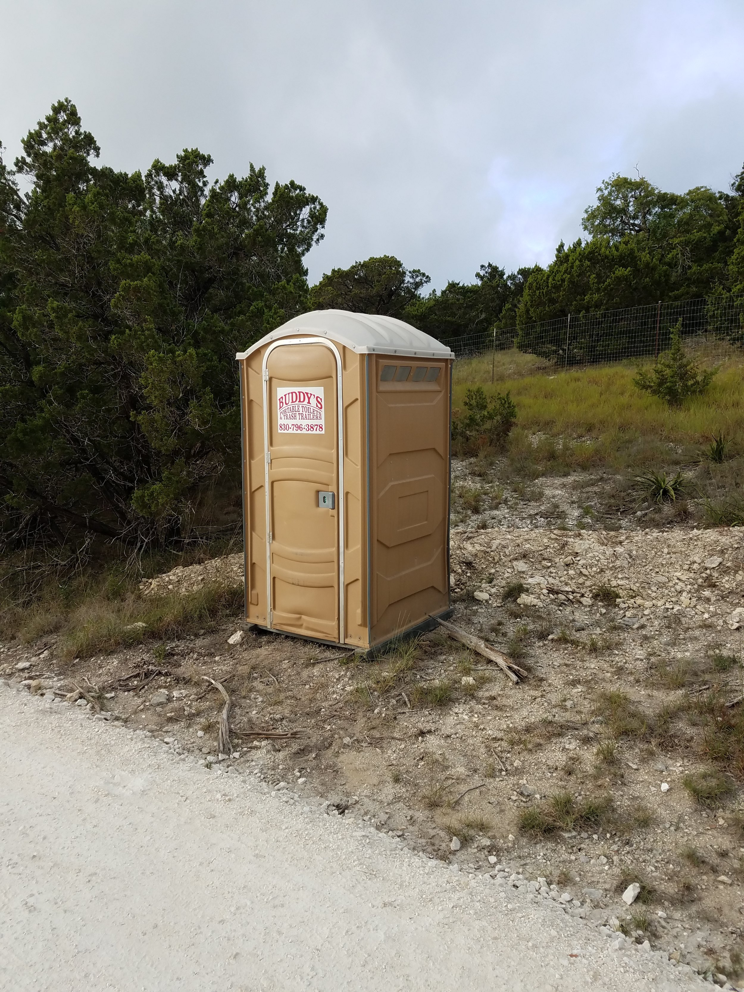 The first sign that things were about to get started...delivery of the port-a-potty!