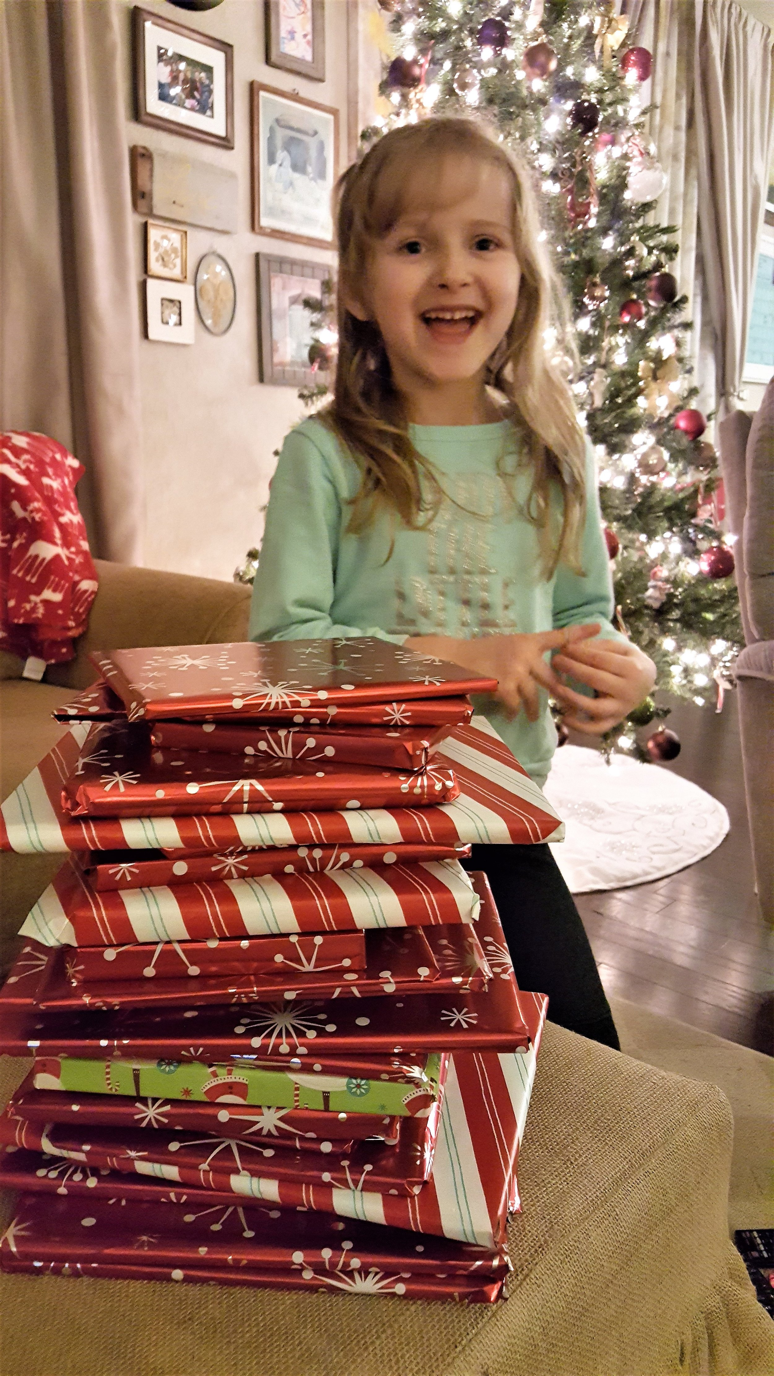 Pretty sure this is her FAVORITE pre-Christmas activity!