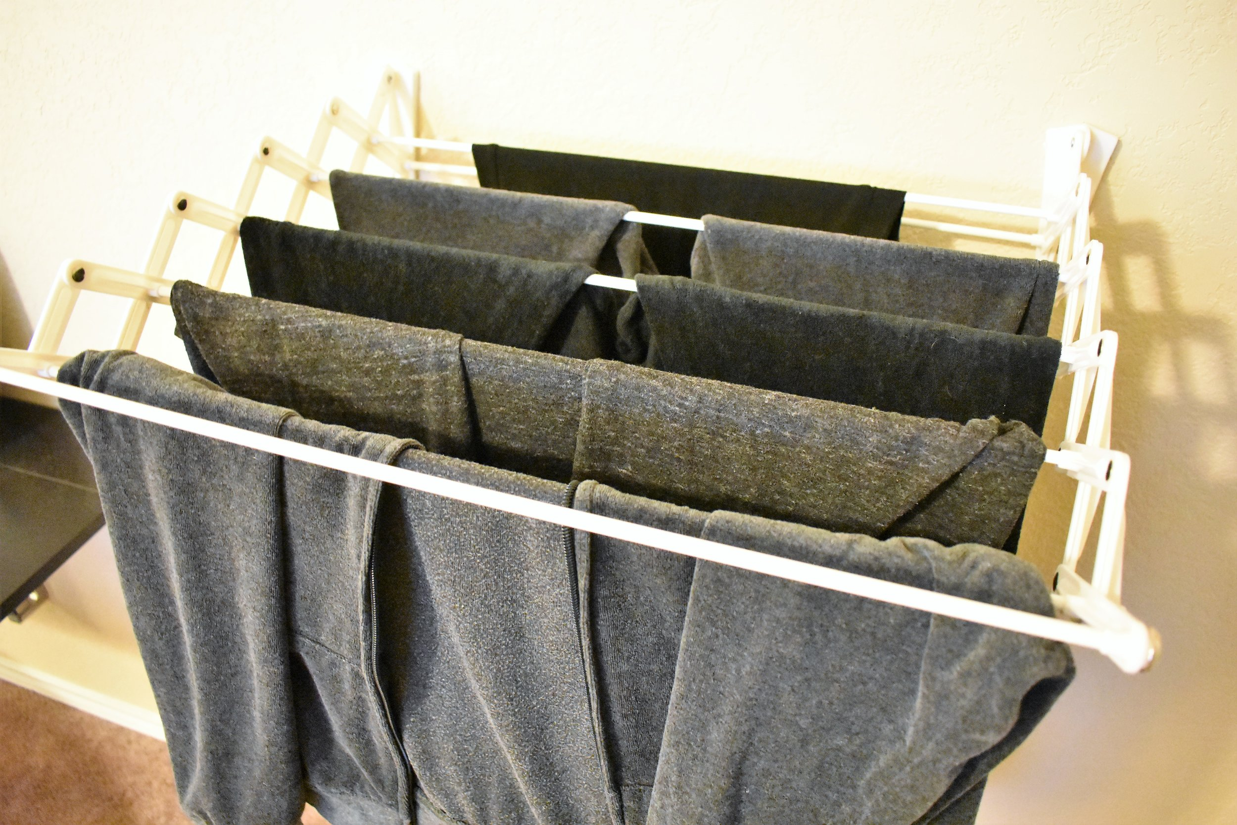 clothes drying rack - laundry room storage and organization