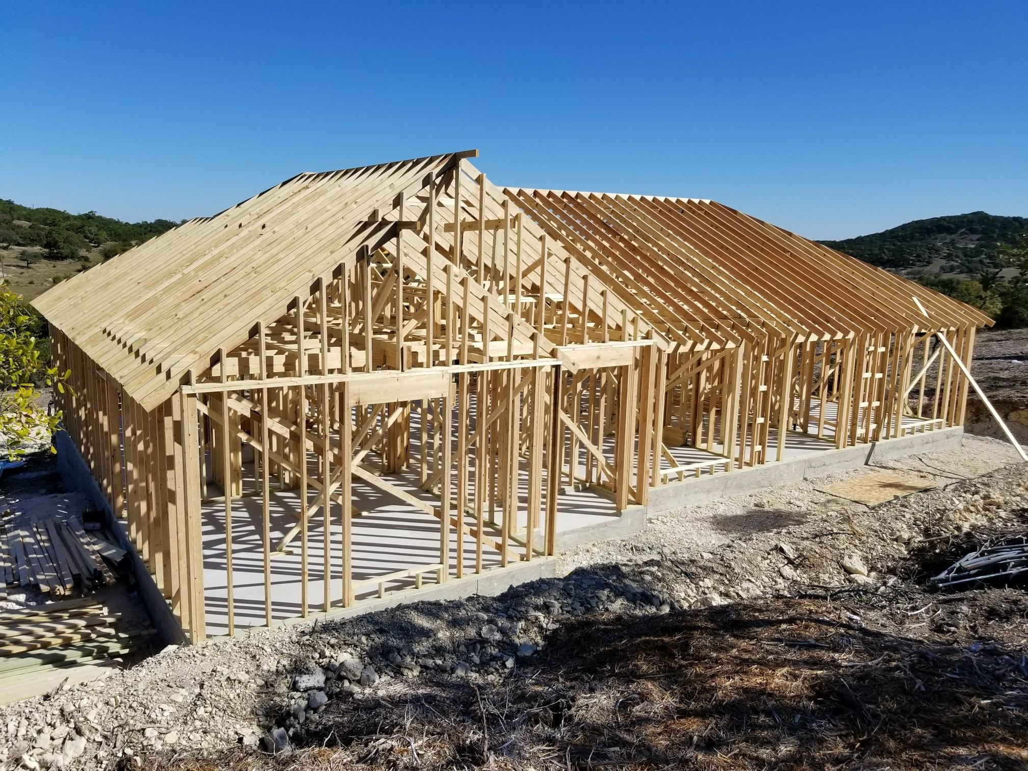 house at framing stage of construction