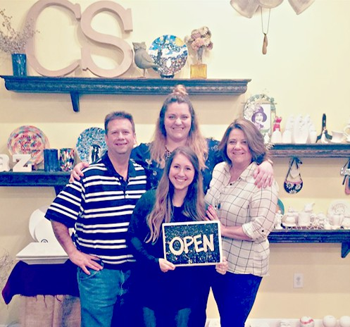 Kristen Lewis poses with the former owners of Boerne's Captured Sunshine, upon her purchase of the pottery studio.  Image Source