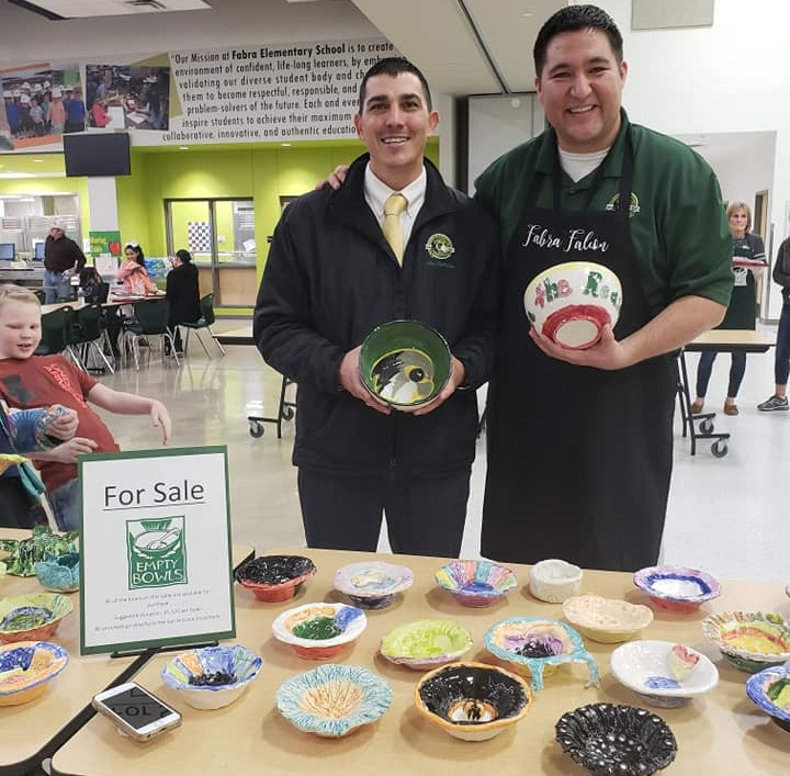 Fabra Elementary Assistant Principal, Troy Latiolais, and Principal, Heberto Hinojosa, at the school's Empty Bowls event, January 31, 2019 ( Image Source )